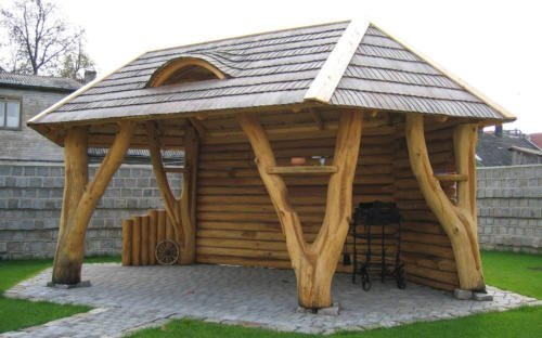 Rustic gazebo with tree posts