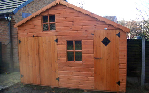 Large wooden childrens playhouse