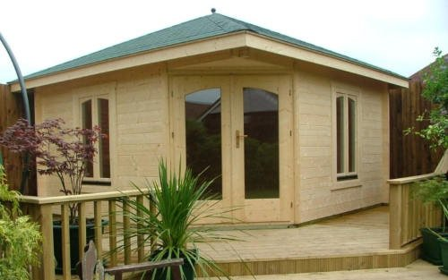 large timber summerhouse with decking