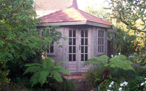 Timber summerhouse with French doors